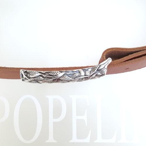 cinturó de pell de vaca per texans amb sivella metàl·lica. Popelin Barcelona